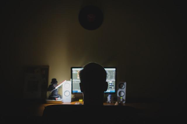 man computer dark